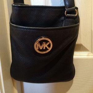 Michael Kors crossbody black with gold MK emblem